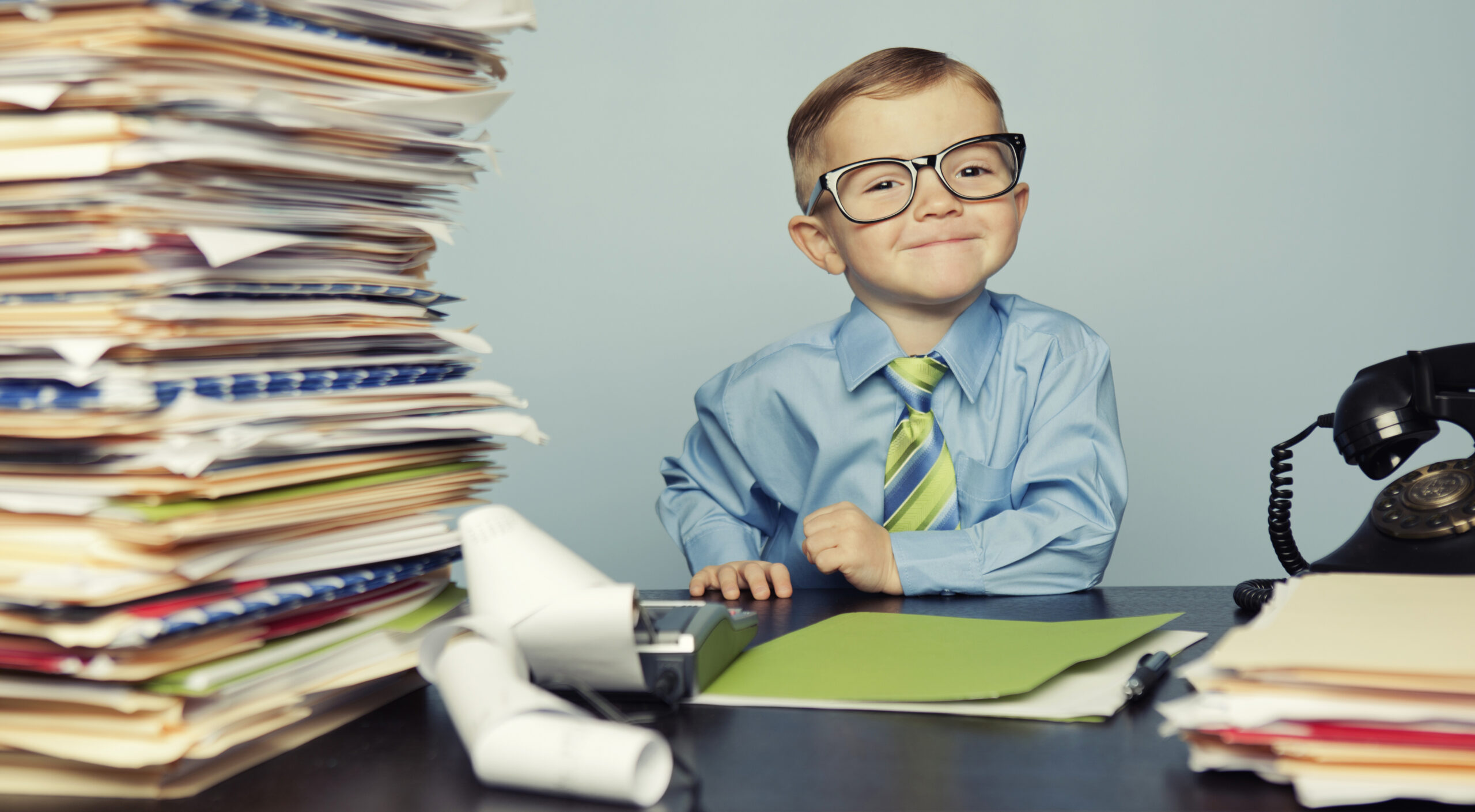 A young boy accountant is ready to crunch your numbers this tax season.